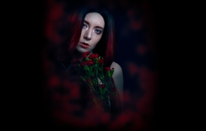 sensual portrait photography featuring blue eyes and red hair.