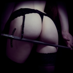 NSFW naughty cosplay of a Queen and her sword