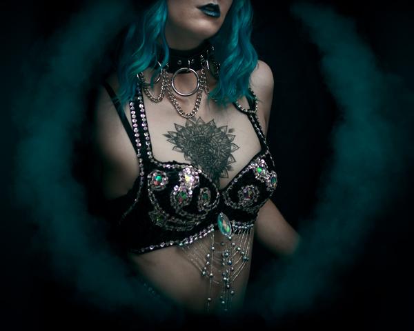 Detail photo of a burlesque artist's sequin bra