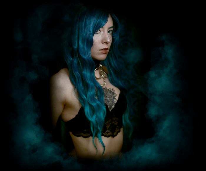 Alternative boudoir portrait of a femme with blue hair
