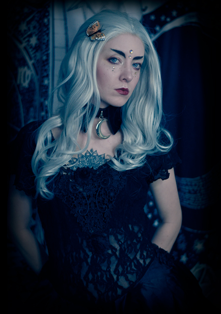 portrait photograph of a white witch in a gothic dress