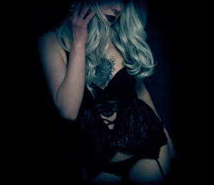 Boudoir portrait photography of a white witch