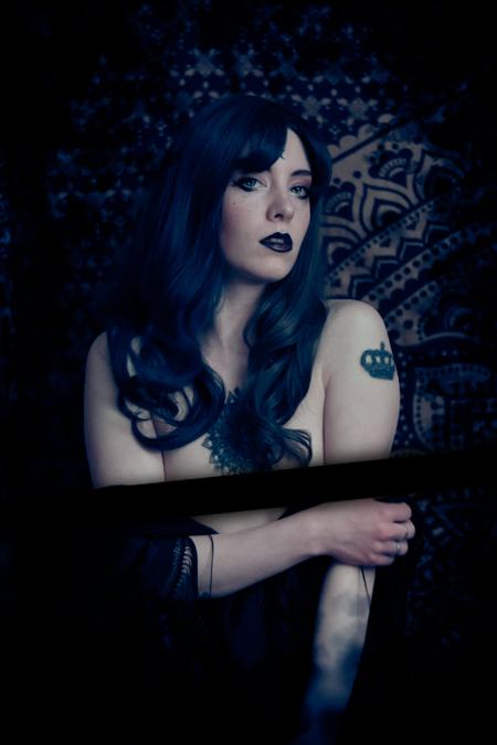 NSFW sensual portrait of a sexy boudoir witch