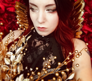 goth goddess in golden floral and wings