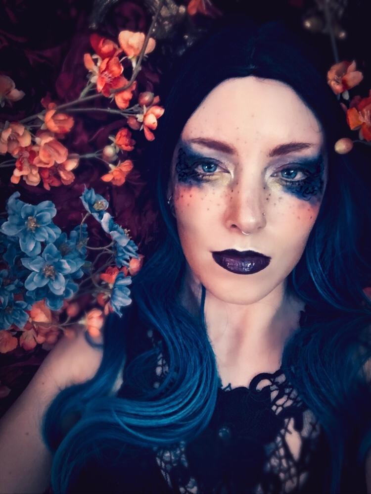 Glamour portrait featuring blue fantasy makeup