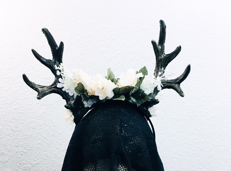 Fantasy floral headdress featuring bronze antlers and cream florals